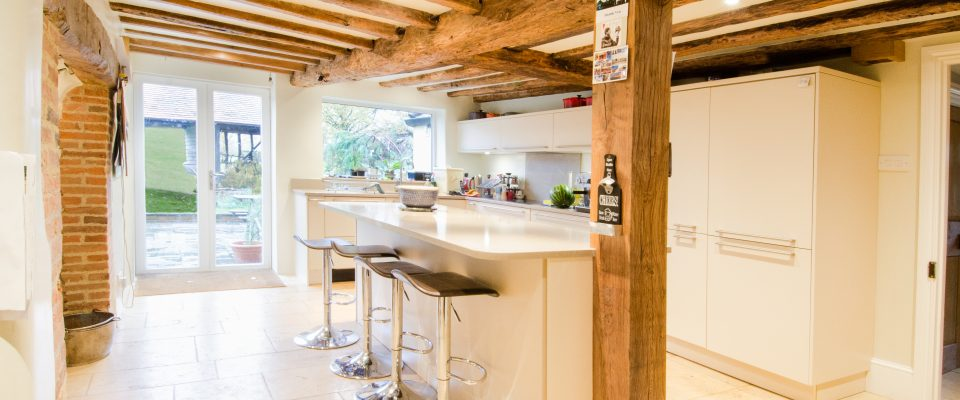 Kitchen with exposed beams